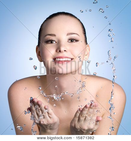 Happy Young Woman Washing Her Face