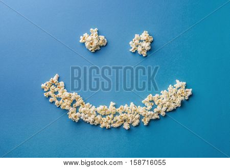 A smiley sign made by pop corn. A concept.