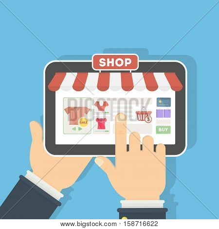 Isolated clothing store in tablet. Storefront with sign of sales, and credit card. Concept of online shopping.