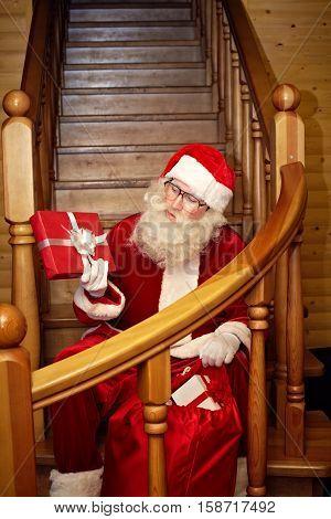 Santa Claus preparing Christmas presents for kids on Christmas