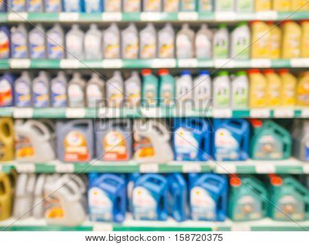 Blurred Motor Oil On Shelves In Supermarket