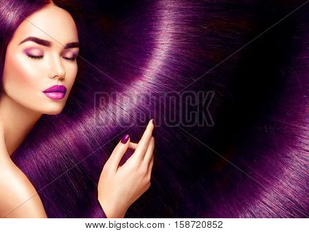 Beautiful Hair. Beauty woman with luxurious long straight red hair as background. Beautiful Model girl touching Healthy Hair. Lady with long smooth shiny straight hair. Hairstyle. Cosmetics, haircare poster