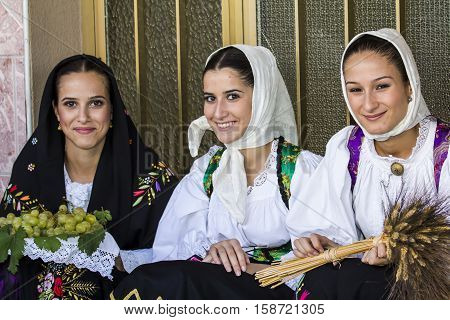QUARTU S.E., ITALY - September 17, 2016: Parade of Sardinian costumes and floats for the grape festival in honor of the celebration of St. Helena. - Sardinia - portrait of beautiful girls in traditional Sardinian costume