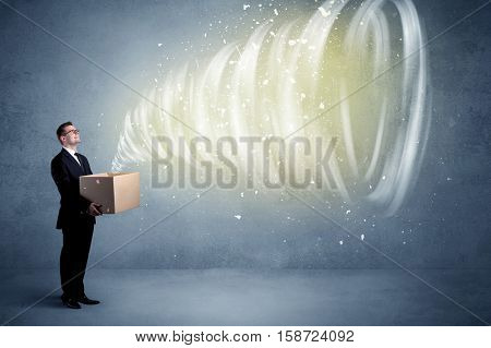 An illustrated powerful whirlwind escaping, coming out of empty paper box held by elegant businessman concept.