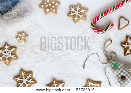 flat layout of the figure of cookies candy striped soft Christmas toys / miscellaneous surprises from Santa's boot