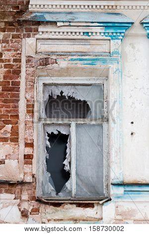 Broken window in an old Russian building. Abandoned building with broken windows