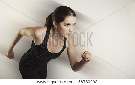 Running Caucasian Woman Studio Isolated On Bg With Blur Motion