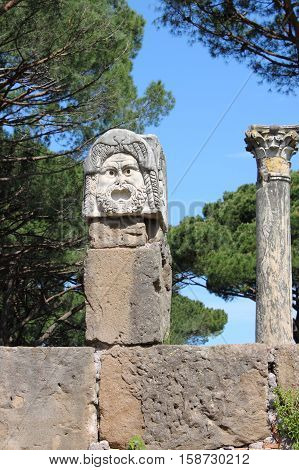 Satiric mask in Ostia Antica the old Harbour of Rome, Italy
