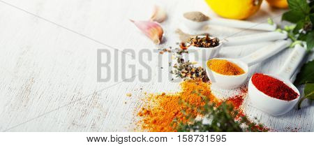 Herbs and spices selectionon rustic background