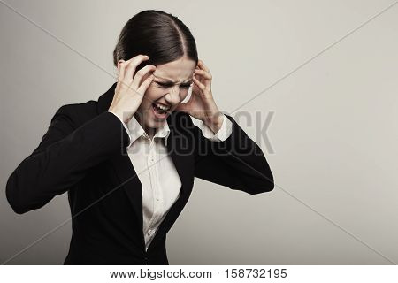 Young Business Woman Suffering Head Pain Or Migraine Isolated On White Background