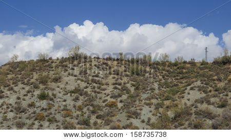 Clouds Behind Hill