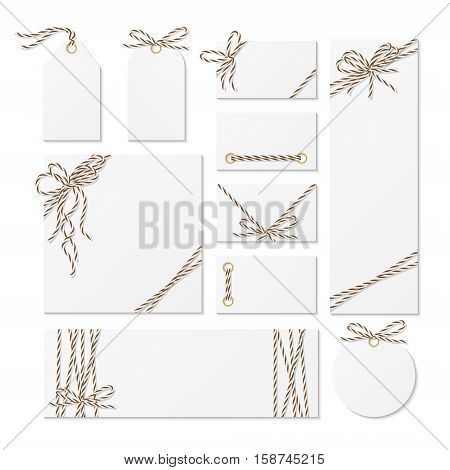 Set of cards, tags and labels tied up with brown bakers twine bows and ribbons