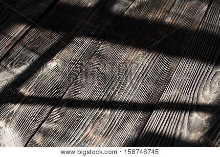 Old hardwood floor with shadows. Horizontal photo