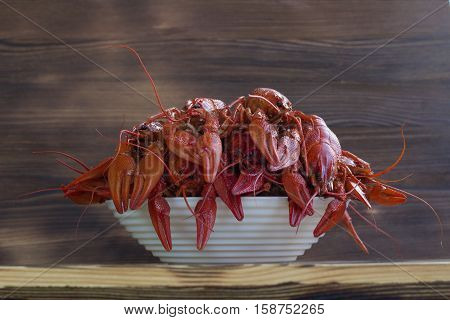 Plate Of Red Clawfishes On Wooden Background