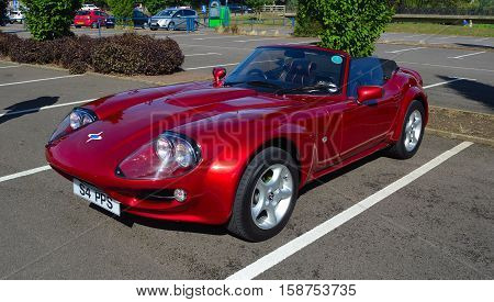 ST NEOTS, CAMBRIDGESHIRE, ENGLAND - SEPTEMBER 11, 2016: Classic Red 1999 Marcos Mantara Sports car.