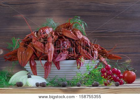 Red Boiled Crayfishes, Fennel, Onions, Peppers, Tomato On Wooden Background