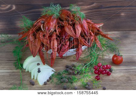 Boiled Crayfishes, Fennel, Onions, Peppers, Tomato On Wooden Background