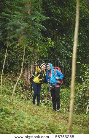 Female hiker showing something interesting to her boyfriend