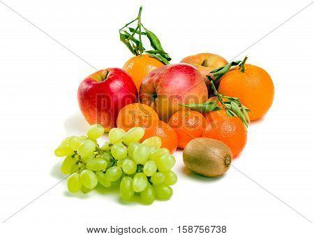 a lot of fruit on a plate. Apple, mandarin, orange, kiwi, grapes.