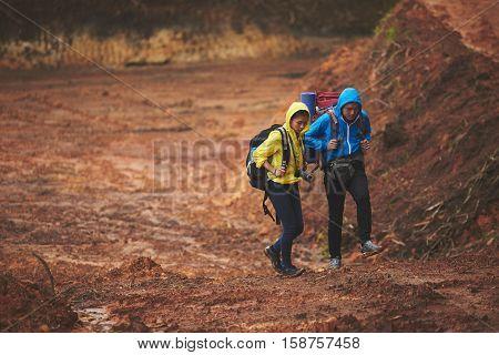 Vietnamese young couple trekking in open pit