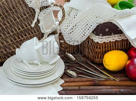 crockery and cutlery baskets of fruit picnic rustic style