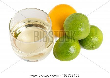 Wine and limes as a ingredients for baking cake. Isolated on a white background.