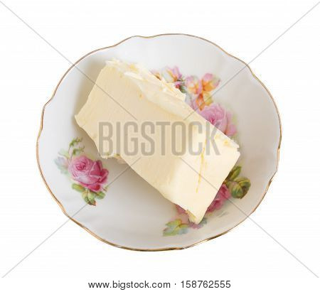 Closeup of fresh butter as a ingredient for baking cake. Isolated on a white background.