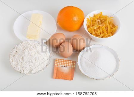 Various ingredients for baking cake. Located on a white background.