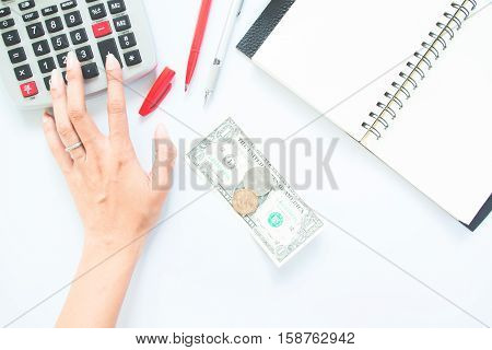 Accounting concept with hand pressing on calculater