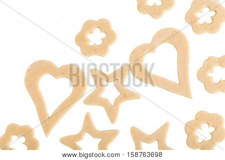 Raw cookies with various form. Isolated on a white background.