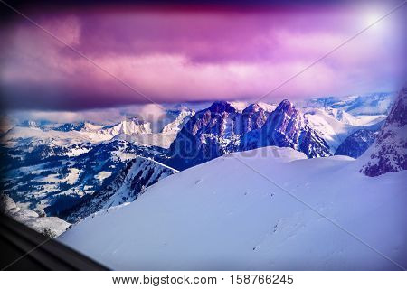 Winter mountains Switzerland in sunshine. Nature landscape. Mountainside and deep snow.