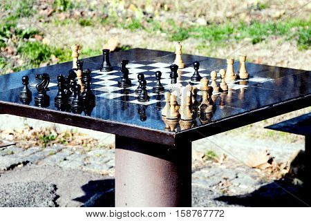 chess table and chessman in the park.
