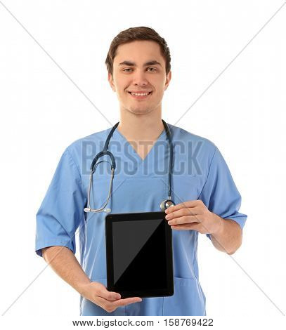 Young male doctor with tablet on white background
