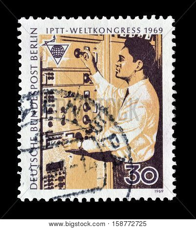 BERLIN - CIRCA 1969 : Cancelled postage stamp printed by Berlin, that shows Telecommunications Technician.
