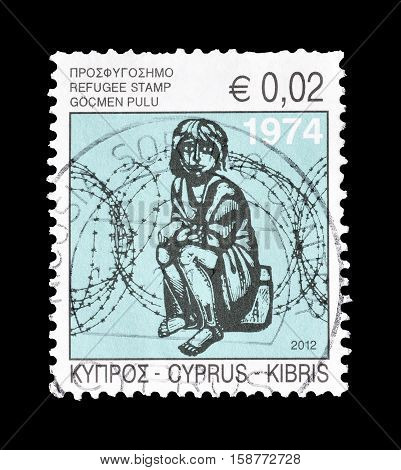 CYPRUS - CIRCA 2012 : Cancelled postage stamp printed by Cyprus, that shows Refugee.