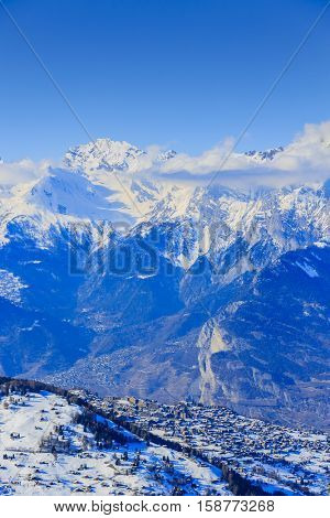 Veysonnaz mountain village in the Valais canton, situated on a slope above  city Sion, with beautiful view over the Rhone Valley and to the Bernese Alps.