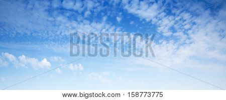 Natural blue sky with white altocumulus clouds panoramic background photo texture