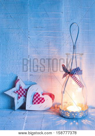 Christmas decorations  and   lantern at the  evening .  Toned image.  Focus on the heart