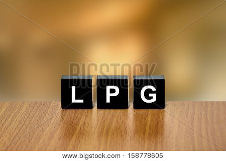 LPG or Liquefied Petroleum Gas on black block with blurred background