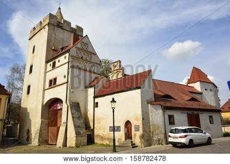 Naumburg, Germany - April 13, 2016. Old town gate Marientor in Naumburg forms a part of medieval town fortifications. View with surrounding buildings and car.