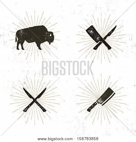 Set of steak house, butcher house and meat tools - crossed carving knives for steak, cut, bison with sun bursts. Retro letterpress design of steak house, bbq equipment. Stock vector.