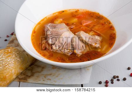 Red hot spicy asian soup with samosa