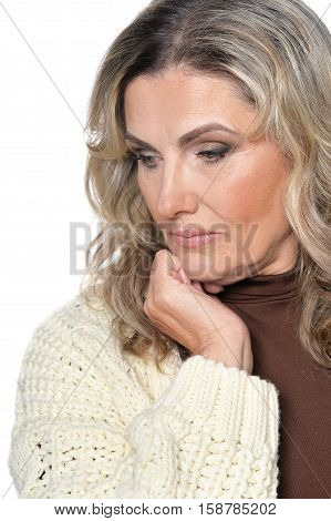 Portrait of thoughtful adult woman isolated on white background
