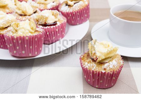 Butterfly cakes A tray of small butterfly cakes with a cup of tea