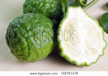 Bergamot Fruit With Leaf On Wooden Board