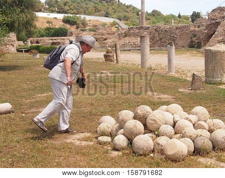 the tourist examines ruins Anthony's term in Carthage