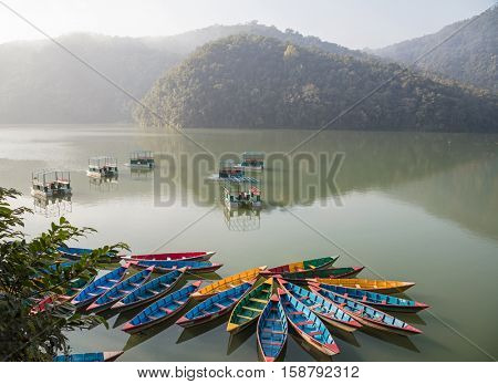 Colour boats on Phewa lake. Pokhara, Nepal
