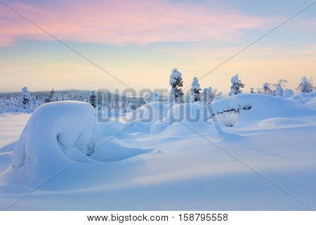 Wonderful Northern Winter Sunset Landscape - snow covered pine trees and big snowbanks, hills valley - wallpaper