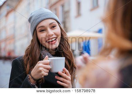 Two fashion friends in cafe. drink coffee. so pretty portrait