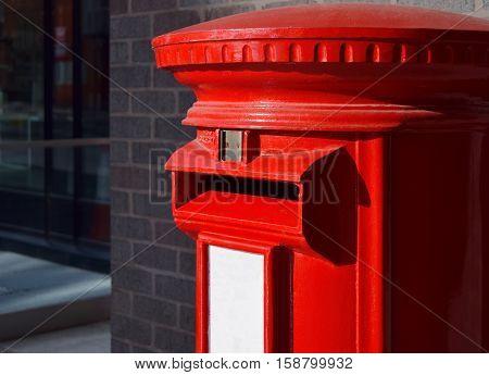 Red mailbox in Birmingham downtown, United Kingdom